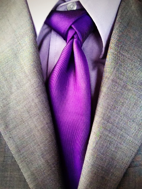 Great color combo! Grey suit, light purple dress shirt, dark purple tie with a subtle Eldredge knot.  Click through for the how to video.