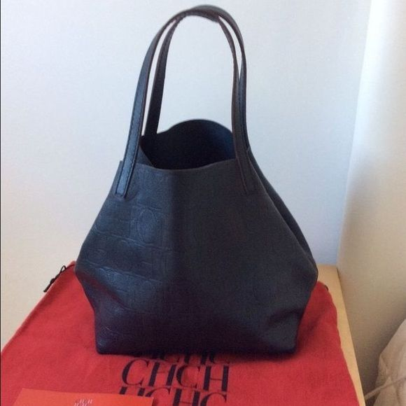Authentic Carolina Herrera Matryoshka Bag! Amazing leather, comes with inside clutch and has an outside pocket. Ideal for travelling, light and elegant. Does not come with dustbag. Carolina Herrera Bags