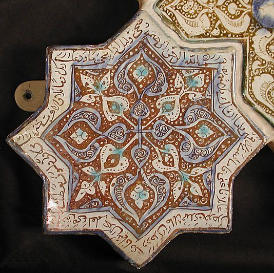 Star-Shaped Tile  Object Name:Star-shaped tile  Date:13th–14th century  Geography:Iran, probably Kashan  Culture:Islamic  Medium:Stonepaste; inglaze painted in blue and turquoise and luster-painted on opaque white glaze  Dimensions:8 x 8 in. (20.3 x 20.3 cm)  Classification:Ceramics-Tiles  Credit Line:H.O. Havemeyer Collection, Gift of Horace Havemeyer, 1941  Accession Number:41.165.20