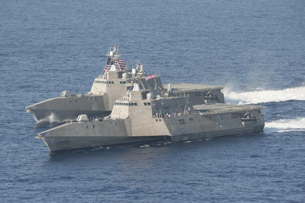 The littoral combat ships USS Independence (LCS 2), back, and USS Coronado (LCS 4) are underway in the Pacific Ocean in April 2014. US Navy photo. The Littoral Combat Ship's anti-submarine warfare mission package needs to shed some weight before it can deploy on a ship, and the Navy awarded three contracts to help find weight-reduction ideas.
