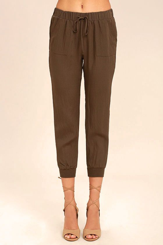 Lulus Exclusive! The Widely-Popular Khaki Jogger Pants are simply the best! Lightweight woven poly falls from an elasticized drawstring waist, into relaxed pant legs with front diagonal pockets and stretchy cuffed ankles.