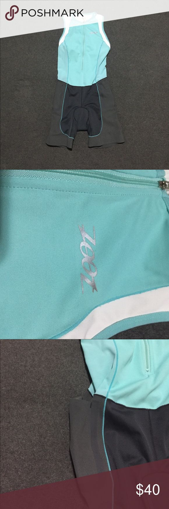 Zoot Triathlon Suit This is a new-without-tags one-piece Zoot triathlon suit. I won it at a race, but have never worn it. Features: lined zip-front tank on top; saddle shorts on bottom with two side pockets (shown in photo); light aqua & gray color design. Zoot Other