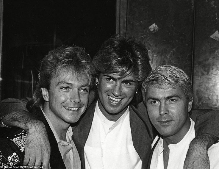 David Cassidy, George Michael and Mike Nolan smiled as they posed for a black and white photograph in the 1980s