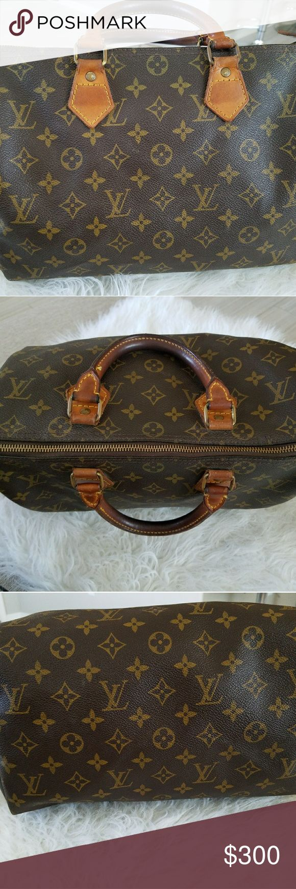 "Louis Vuitton speedy 30 monogram Brown and tan monogram coated canvas Louis Vuitton Speedy 30 with brass hardware, tan vachetta leather trim, dual rolled handles, brown canvas lining, single slit pocket at interior wall and zip closure at top. *Lock with no key, lock code reads 303; Date code reads 882 FC= made in the US Feb. 1986 This in good used condition. No scratches, no fading, inside needs to be cleaned from use.  Handle Drop: 3.25"" Height: 10"" Width: 12"" Depth: 7"" Louis Vuitton Bags"