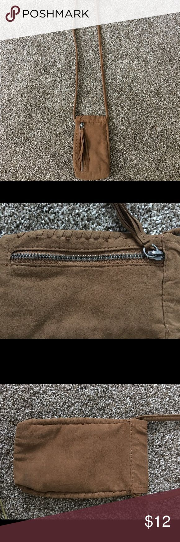 Brown Crossbody Mini Purse Selling this Crossbody purse from American Eagle. 8 inches in length so it's very small. I just used it to store my phone since it's about the same size. Brand new condition. Has a zipper on the outside. American Eagle Outfitters Bags Crossbody Bags