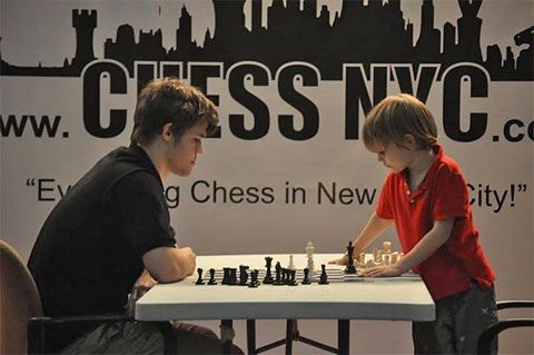 Magnus Carlsen plays chess in NCY