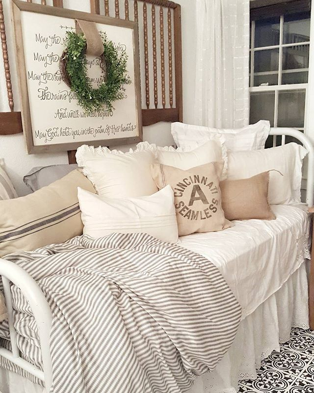 Daybed in french country style with linens and farmhouse pillows. Create a bedroom of your dreams