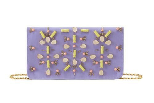 Radiant Orchid cotton canvas beaded clutch purse. Gold hardware cross-body chain. Flap with magnetic snap closure. Inner zip pocket.