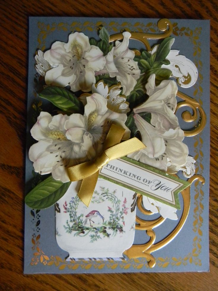 Made with the following Anna Griffin, Inc. products.  Metallic Hues Card Kit, Gold Foil Flourishes, Flower Pot Die Cut and one of her flourish dies, Border stamps and Minc.