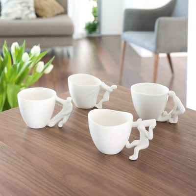 Quirky cream mugs for tea or coffee.