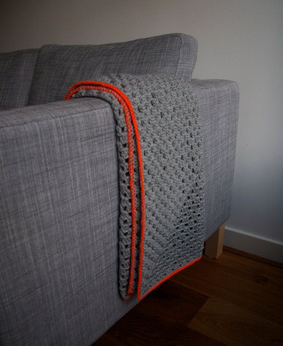 Grey granny square blanket with neon orange by PieceOfaCookie. I like the idea of a solid blanket of one color with a contrasting edge. Hmmmmmm.