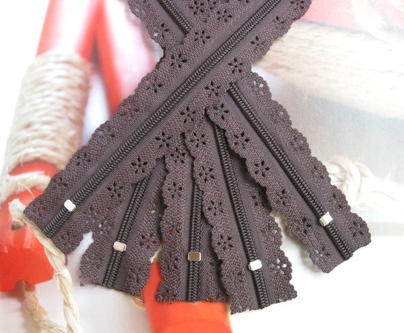 a lacey zipper means you won't even have to do that complicated stitch and unstitch thing to get it on.