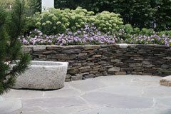 Irwin Stone - How Tos - Build Your Own Stone Wall - Stonewalls are a smart and relatively cheap way to add to a home's decorative and resale value - permanently. Unlike most home improvements, stonewalls are apt to look BETTER with age.  Walls can be used along a home's street fronting, around a patio or to set off different garden levels. Quartzite, bluestone, sandstone and many other varieties are widely available in precut, lightweight sizes ...