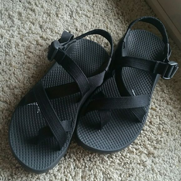 Black Chaco sandles Brand new,  never worn. Runs a little big.  Size 6 but can fit up to a 7 comfortably. Adjustable straps make Chacos one of a kind. Chacos Shoes Sandals