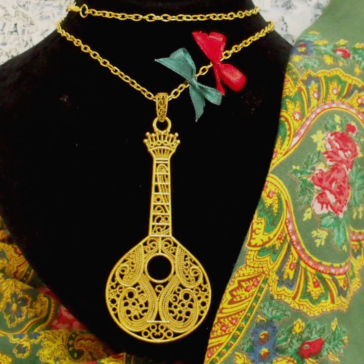 Portuguese Guitar gold tone filigree style pendant necklace. Inspired by Fado and folk Portugal jewelry used by country women in Minho, region in the north of country. Upcycled by me for modern fashion.$39.00..#madeinportugal#portugueseguitar#portuguesefado#guitarnecklace#portuguesefiligree#portugalfolkart#guitarraportuguesa#fado#portuguesenecklace#portugal#helenaaleixo