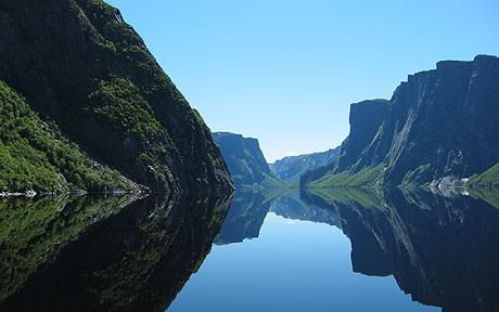 Western Brook Pond in Gros Morne National Park Newfoundland, Canada. You have to walk 45 minutes just to get to the boat dock for the tour but it's all part of the experience and I will never forget it.
