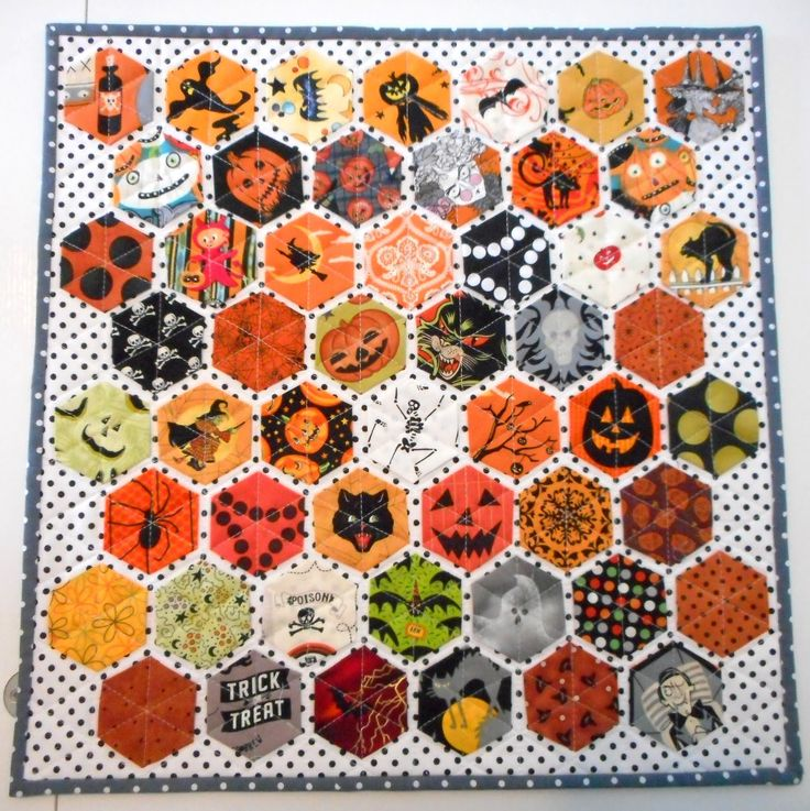 Halloween hexagon mini quilt by Pinkadot Quilts. The hexagons were lightly glued down then quilted from point to point.