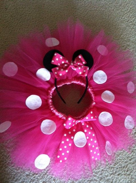 This Listing Is For One Tutu anywhere from 12mths-24mths Minnie Mouse Themed.    Tutu is all made with good quality tulle, White felt spots and a woven matching satin waistband. Also comes embellished with a matching bow embellished on tutu.    ****LIMITED TIME ONLY ! EARS IN PHOTO ARE INCLUDED WITH PURCHASE!**** Remember to choose a size in the drop down bar!    Sizes are run based on these measurements:    12mths: Waist: 16in Length: 9-10in  18mths: Waist: 17in Length: 10in  24mths: Waist…
