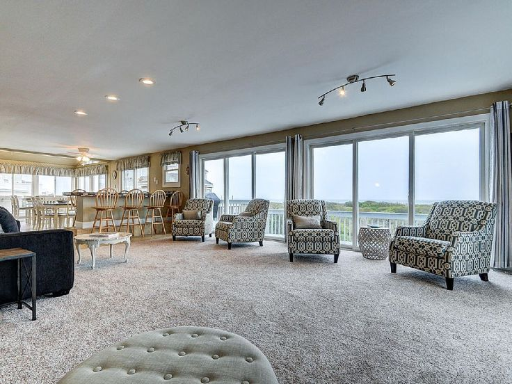 This Newly updated beach and ocean front property is perfect for large parties. There are 5 bedrooms, 2 1/2 bathrooms and is suitable to sleep up to 21 people with all the pull out couches and futons. There is a large ...