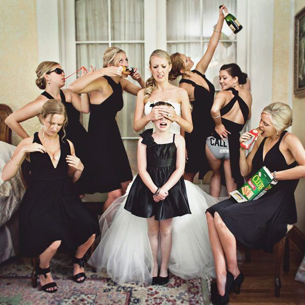 Hahaha! This picture of the bridesmaids, bride, and flower girl is hilarious! :)