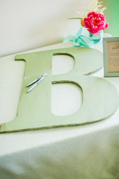 Wedding guest book idea: wooden letter | Photo: Volatile Photography