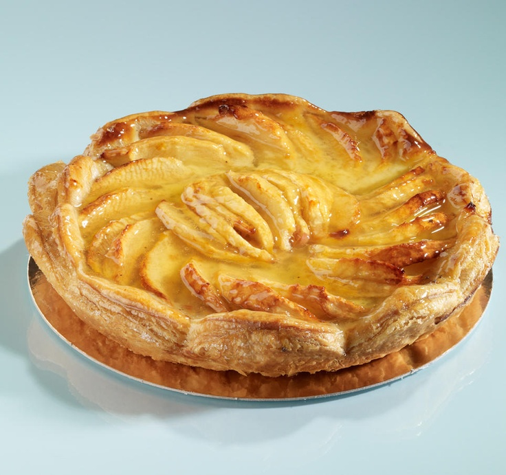 of the apple tart made in Normandy filled with apples, sliced almonds ...