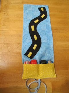 Roll up car caddy with long road flap.  Maybe include extra detached road pieces?