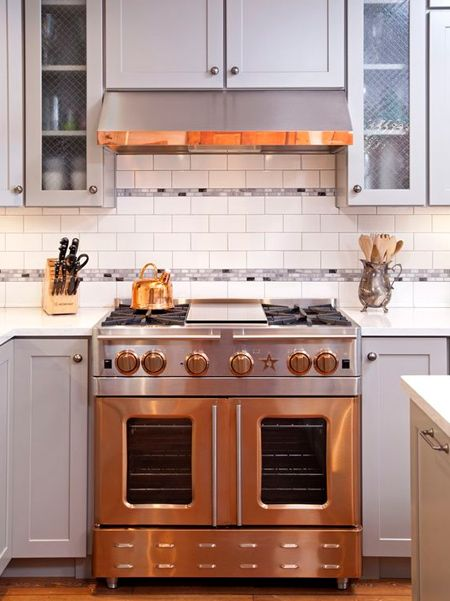 wood mantle hoods are being replaced with metal hoods or a combination of wood and metal