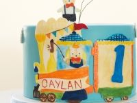 Bear and train hand painted first birthday cake