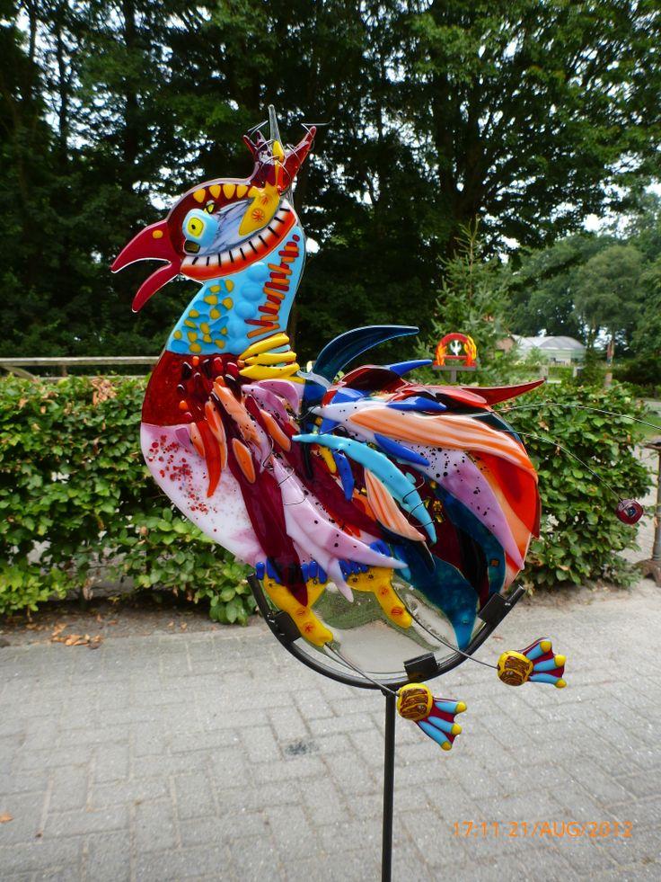 Glass fusing rooster garden sculpture.