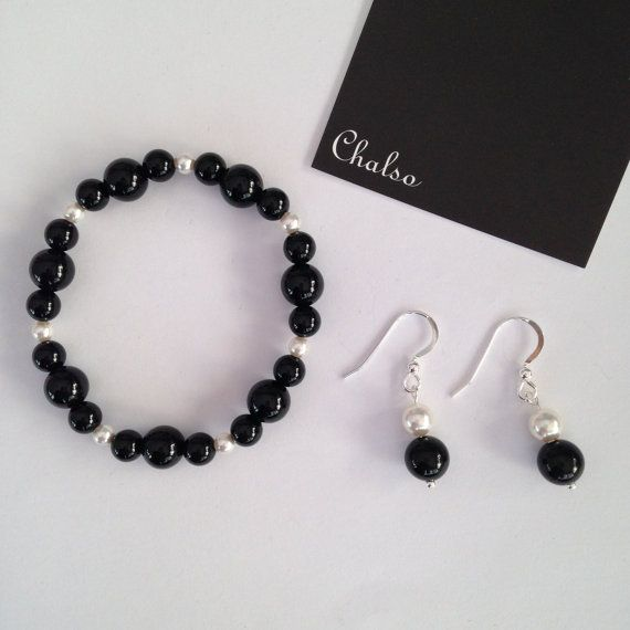 Marvellously monochromatic bracelet and earring set with smooth, shiny black agate and white Swarovski crystal pearls.  The stretch bracelet is made with