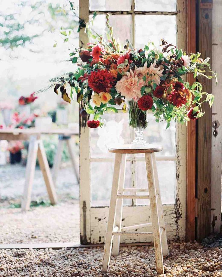 An Elegant-Meets-Rustic Farm Wedding in North Carolina | Martha Stewart Weddings - Other arrangements included many varieties of dahlias, grasses, blackberry lily seedpods, celosia, tuberoses, and lisianthus, as well as spray- and garden-rose varieties.