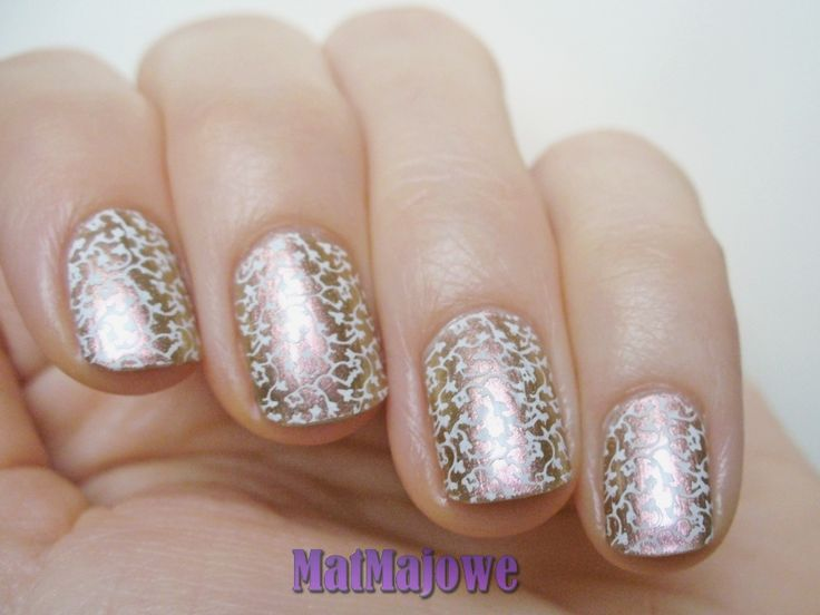 Subtle white stamping over BarryM Caspian with Born Pretty 05 plate. http://matmajowe.blogspot.com/2015/01/delikatnie.html