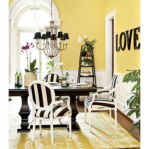 The black and white used with this yellow dining room is very similar to our color scheme.
