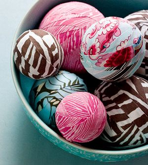 fabric scrap balls from better homes and gardens -- use your favorite fabric lines/scraps and place in a basket or bowl in the entry-way on a side table for a lovely decor piece! Mix and match swatches using one of the ornament tutorials!
