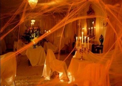 Halloween party decor @Leslie Lippi Lippi Riemen Chaney white sheets, fake cobwebs, candelabra, and colored light bulbs - brilliant!