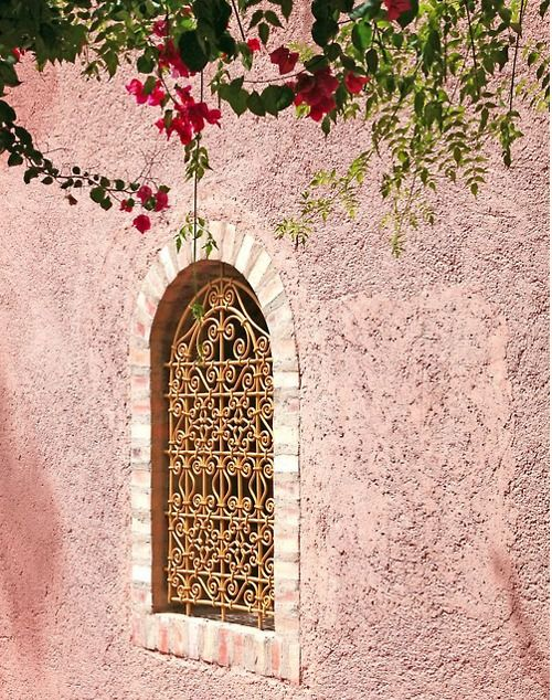 pink stucco with iron grille