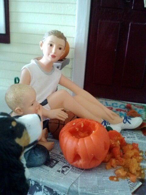 Carving mini pumpkins