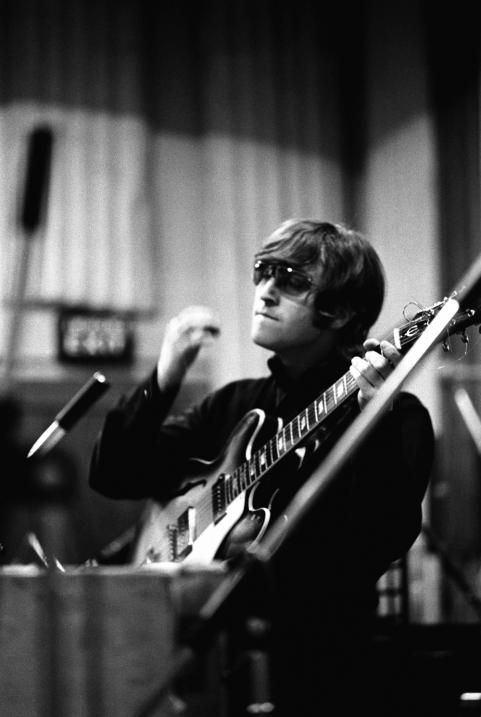 """John during a recording session for the album """"Revolver"""" - The Beatles"""