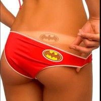 Batman bikini with logo cut out to get a tan.