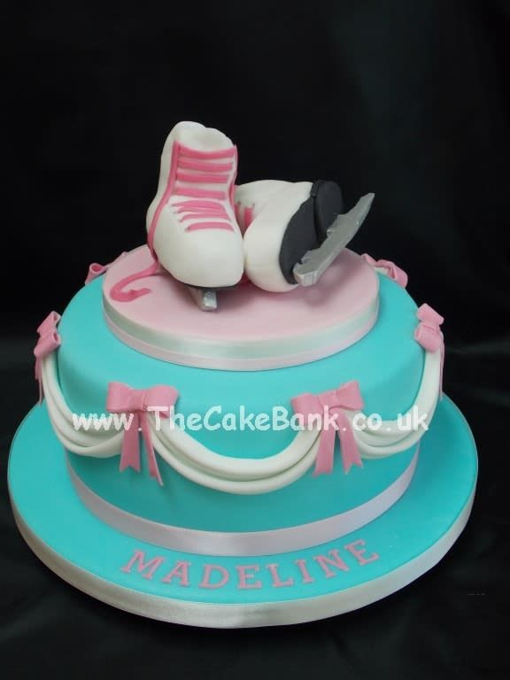 A pretty cake for a little girl who loves Ice Skating. I have never made a cake with swags or made Ice skates before so am happy with these. xx