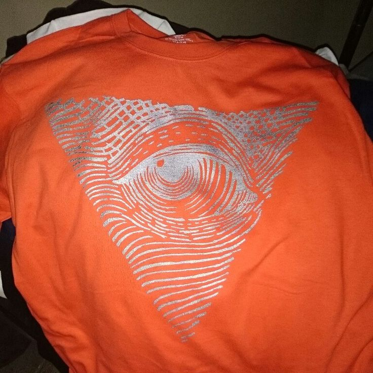 Orange shirts with the silver eye