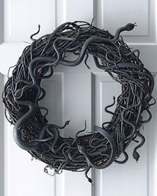 Snake wreath using different sized rubber snakes glues to a grapevine wreath and then spray painted black