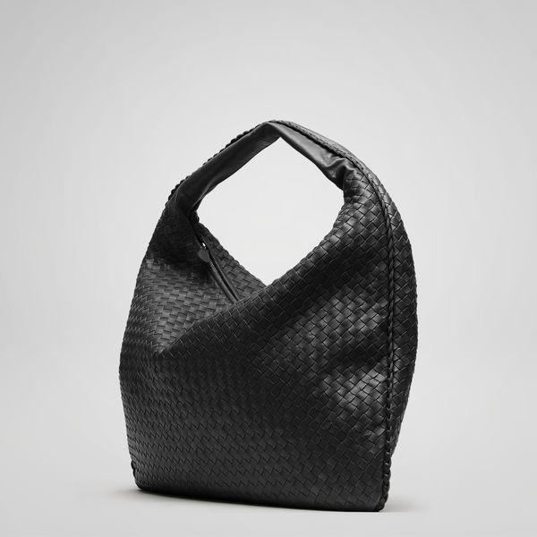 the traditional Veneta is a signature element of Bottega Veneta's handbag  collection. Dimensions:21.7