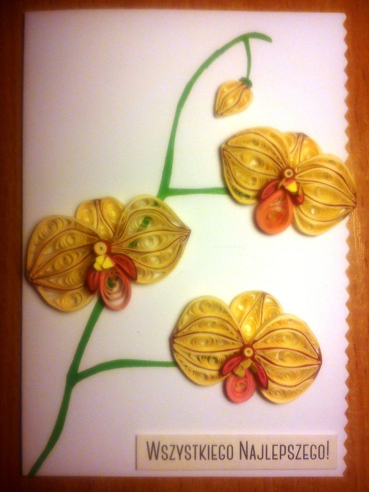 Quilled orchids on a greeting card.