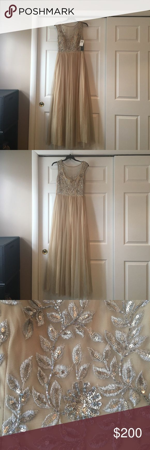 Aidan Mattox Cream Gown This is a BNWT Aidan Mattox Cream gown. It is a size 2 and comes with extra beads. The top is a beautiful illusion with beading. It had a tulle skirt that is A line. Aidan Mattox Dresses Prom