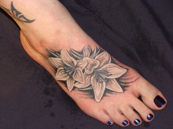 lily - 50 Awesome Foot Tattoo Designs | Art and Design