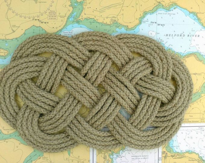 This nautical turks head knot was originally made by sailors as a protective mat to stop blocks and pulleys knocking and damaging the ship. The hole in the centre was where the bolt or shackle came through to attach the block to the deck, so as it moved around, the rope mat acted as a cushion. This woven mat has a traditional appearance too, reminiscent of Celtic knots. Good for a teapot trivet!  It is an attractive knot, so nowadays it could be used as a table mat, or under a plant pot or…