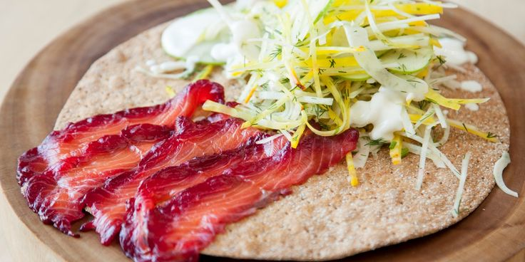 Anna Hansen's salmon gravlax recipe sees the salmon cured with a heady mix of beetroot, liquorice and soy, creating a light yet visually stunning dish.