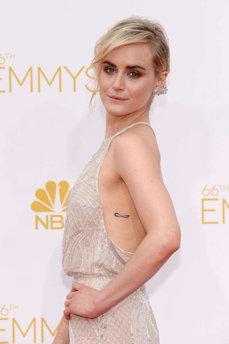 Taylor Schilling wore a 60s-inspired updo with a volumized messy chignon. // #Emmys2014